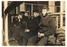 Lewis Hine(1874-1940)  -  Ellis Island (Men And Women Waiting On A Bench) - Postcard -  A16775-1