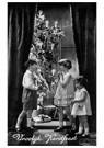 A.N.B.  -  Drie kinderen bij een kerstboom met cadeaus (Vroolijk Kerstf - Postcard -  A98293-1