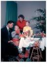 Spaarnestad Fotoarchief,  -  Kerstmis, gezin aan tafel bij de kerstboom - Postcard -  D1180-1