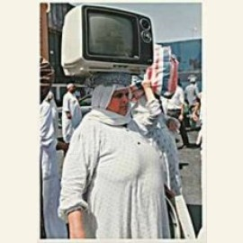 Egyptian woman with a T.V.